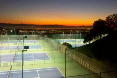 Tennis courts view at sunset.